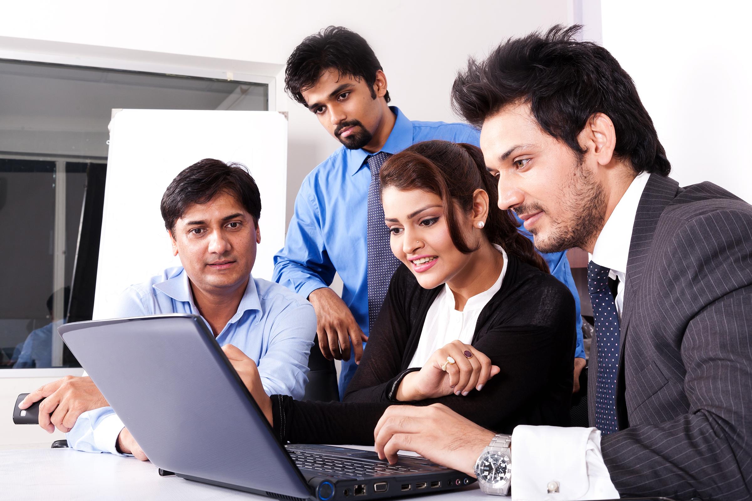 People around laptop